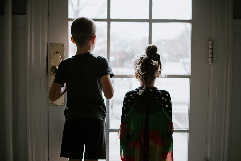 children at window during lockdown